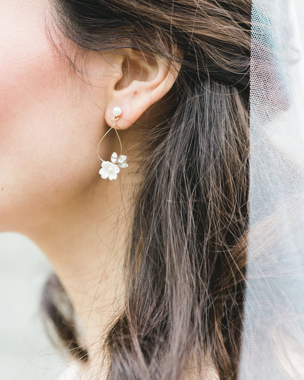 close-up of model wearing Belle Fleur gold Earrings in freshwater pearl and swarovski crystal