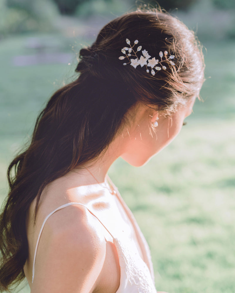 Model wearing Belle Fleur flower swarovski crystal hair pins half up bridal hair