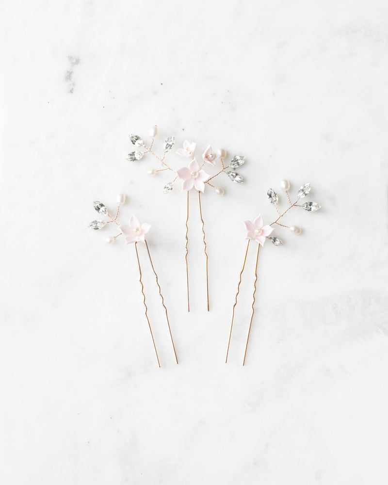 details of the Belle Fleur rose gold hair pins with swarovski crystals and freshwater pearls
