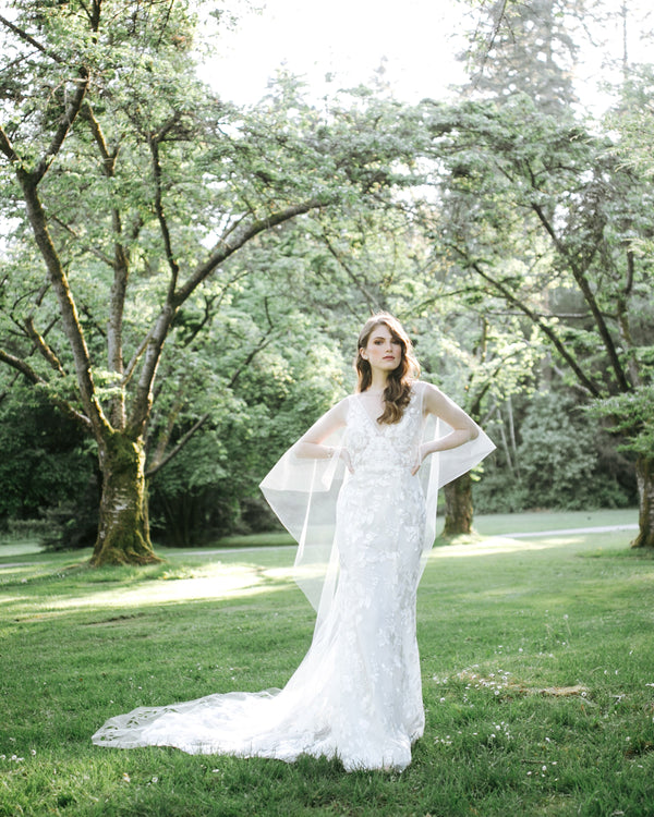 model wearing Cascading Leaves long tulle bridal cape