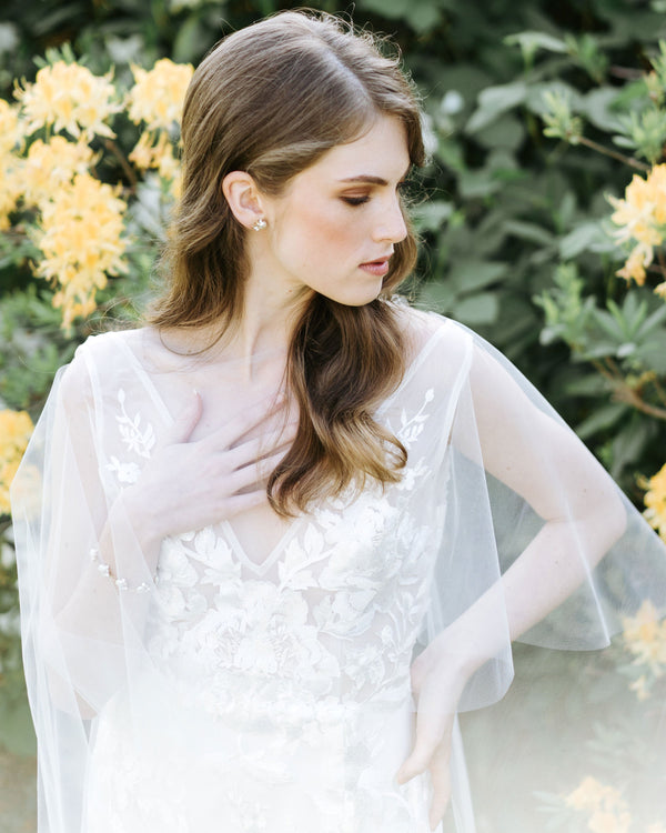 model wearing cascading leaves sheer wedding cape