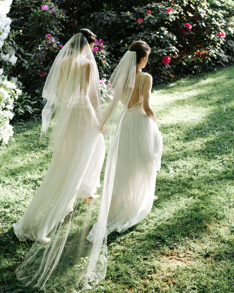 Model wearing cascading leaves long tulle wedding veil