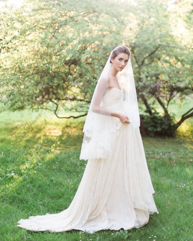 model wears short bridal veil with blusher