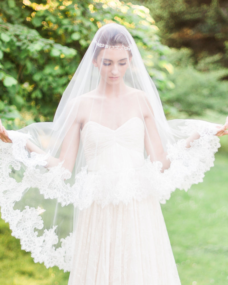 Model wears cassia short wedding veil with blusher