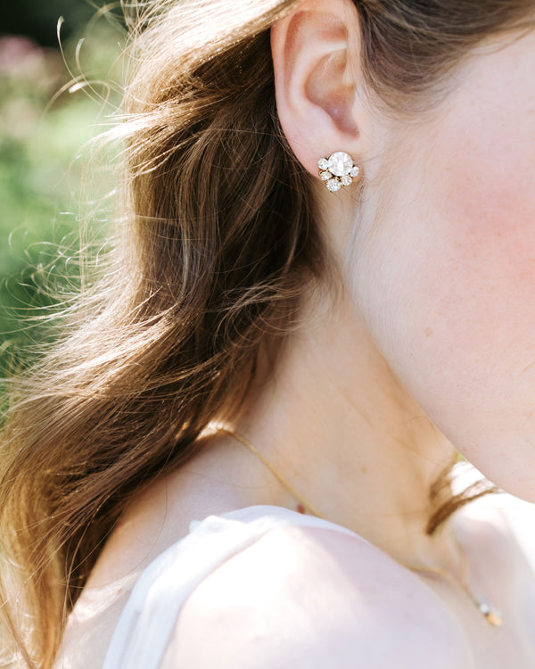 Model wearing celestial crystal cluster stud earings with swarovski crystals and gold