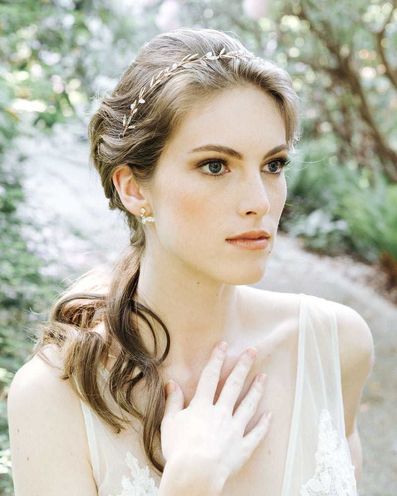 model wearing swarovski crystal leaf earrings in gold bridal jewelry