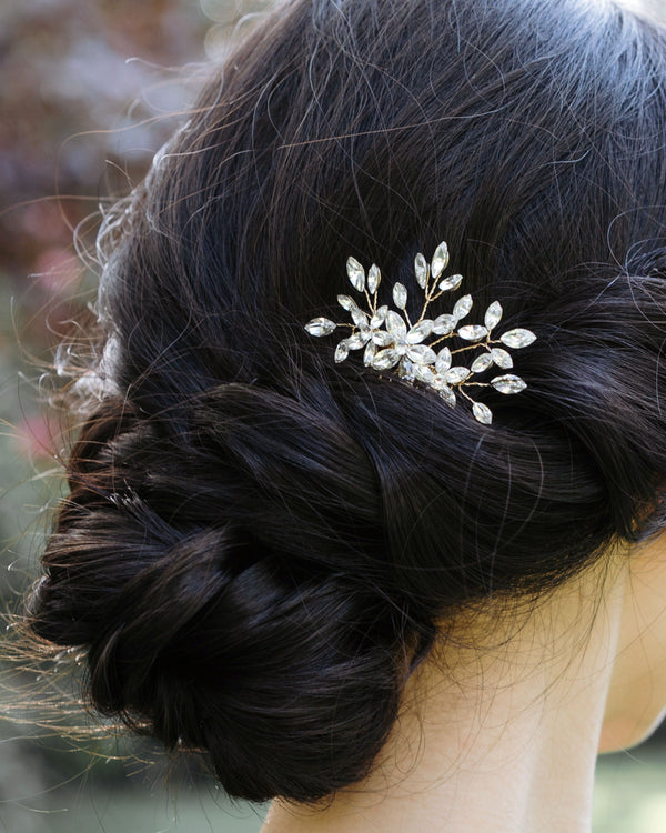 model wearing delicate swarovski crystal leafy starburst hair comb in silver