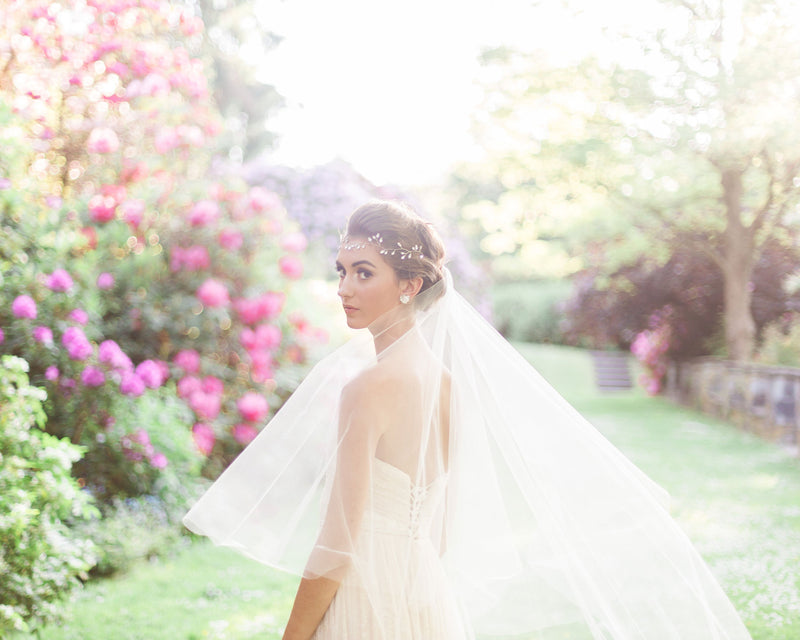 Model wearing circular cut illusion tulle chapel veil without gathers
