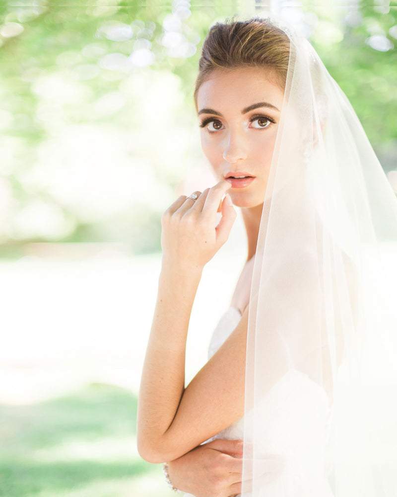 Model wearing circular cut blusher fingertip veil without gathers