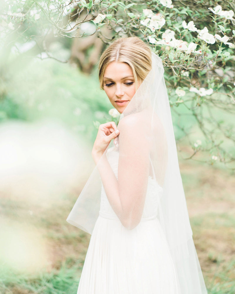 Circular cut illusion tulle fingertip veil with soft gathers