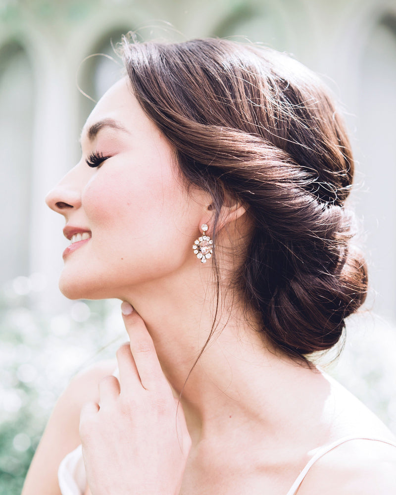 model wearing enchanted blush swarovski crystal drop earrings in gold