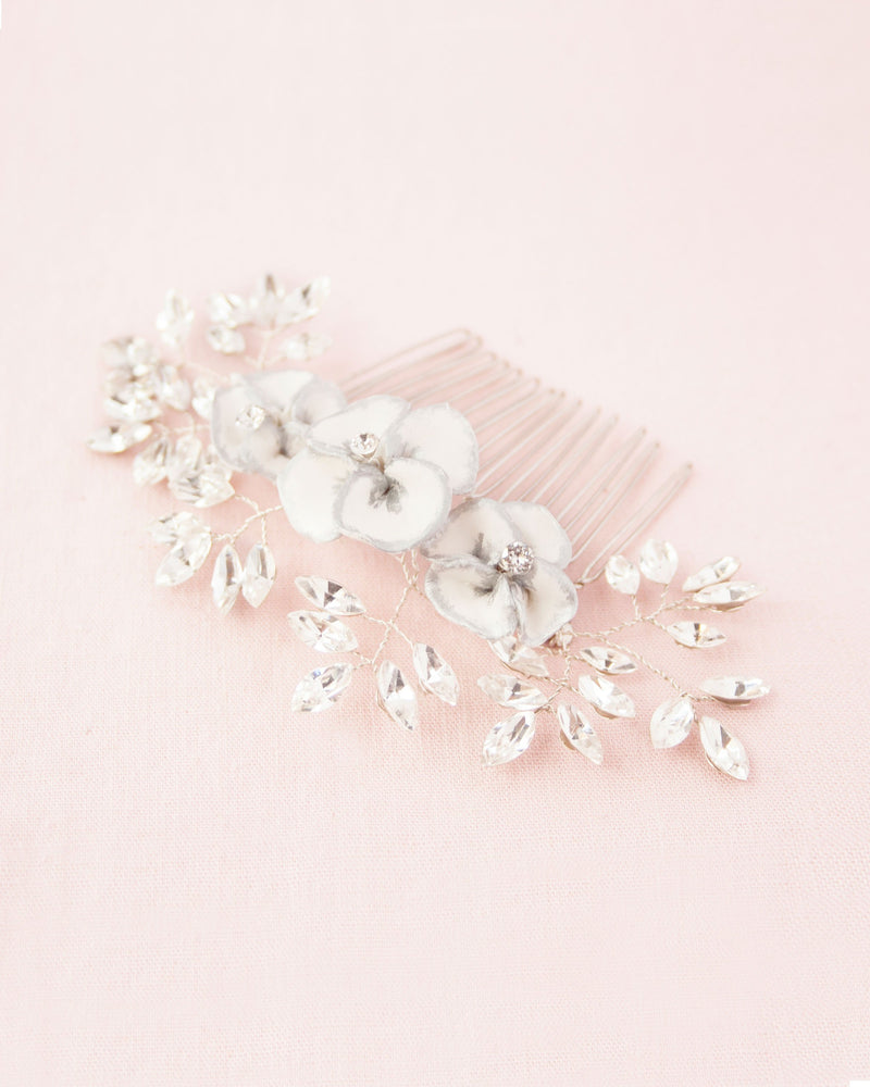 Delicate comb of hand-painted flowers, freshwater pearls and scattered crystals.