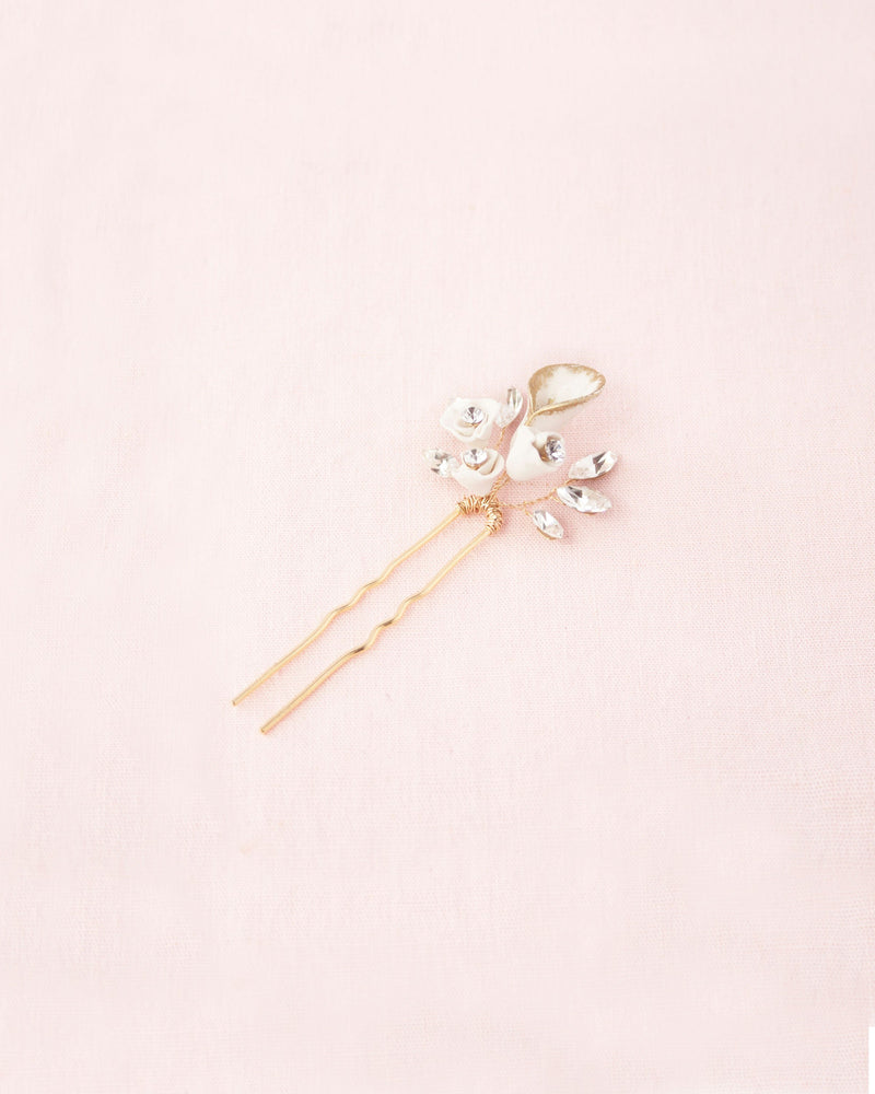 hair pin of hand-painted clay flowers and scattered Swarovski crystals