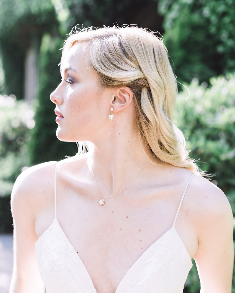 Model wearing the Halo Pearl Drop Necklace styled with the matching Halo Pearl Drop Earrings