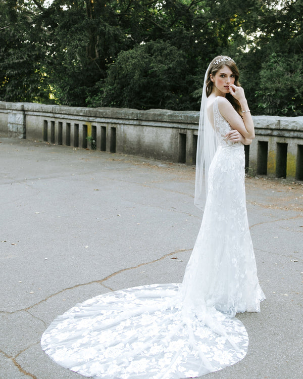 model wearing lily plain fingertip wedding veil