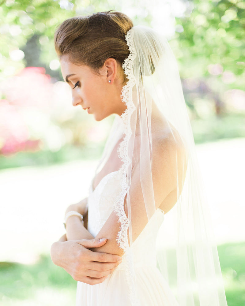 model wearing Magnolia fingertip length lace bridal veil
