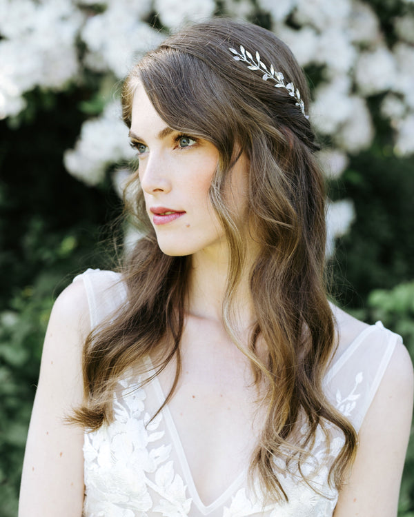Model wearing seamist hair comb in rose quartz and silver