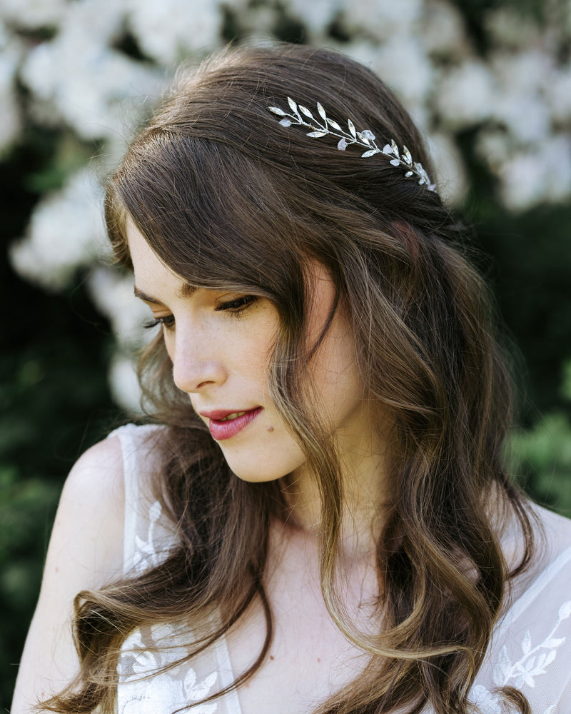 Model wearing seamist wedding hair comb in rose quartz and silver with swarovski crystals