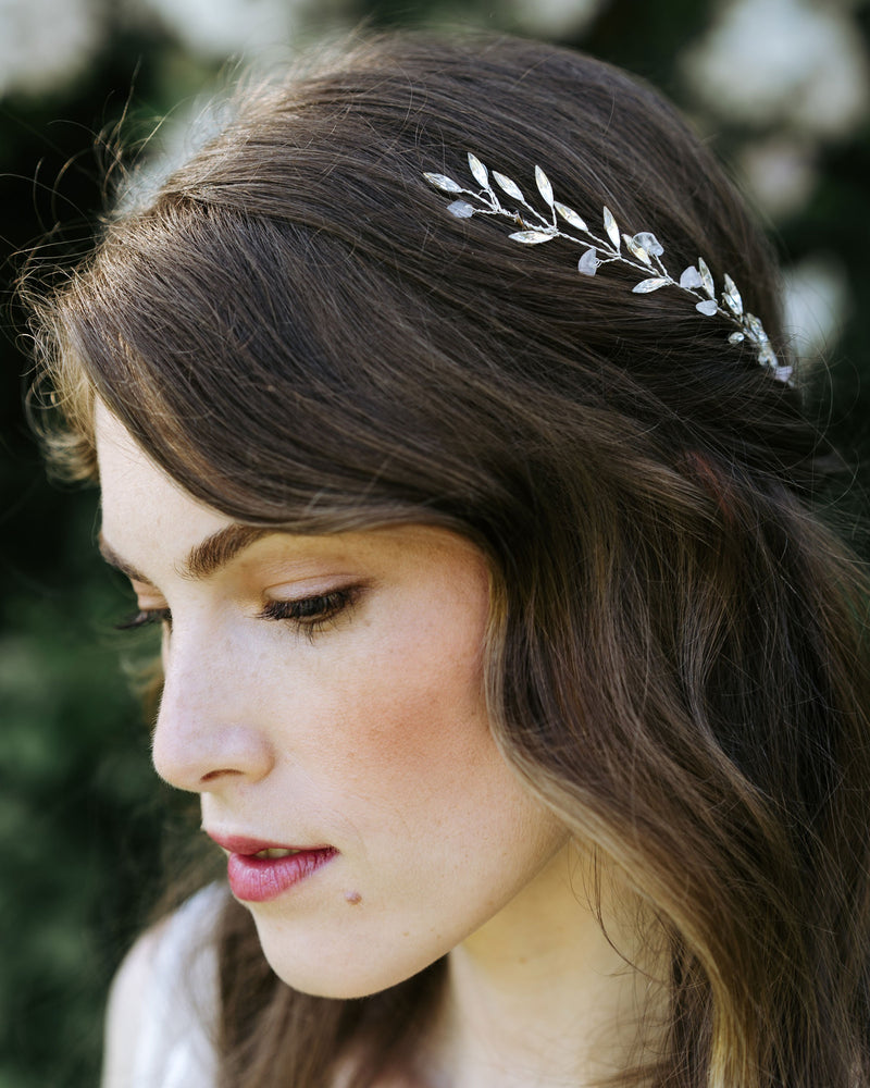 Model wearing seamist hair comb in rose quartz and silver with swarovski crystals