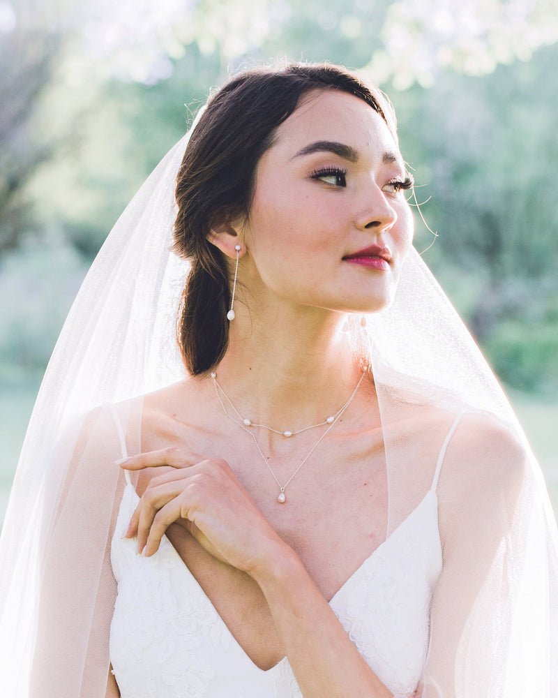 Model wearing Teardop pearl Long drop earrings with veil