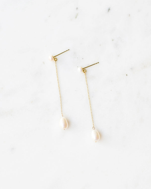 Flatlay of Teardop freshwater pearl Long drop earrings gold