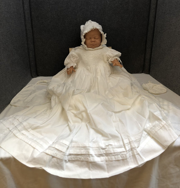 Baby doll dressed in  vintage Christening gown