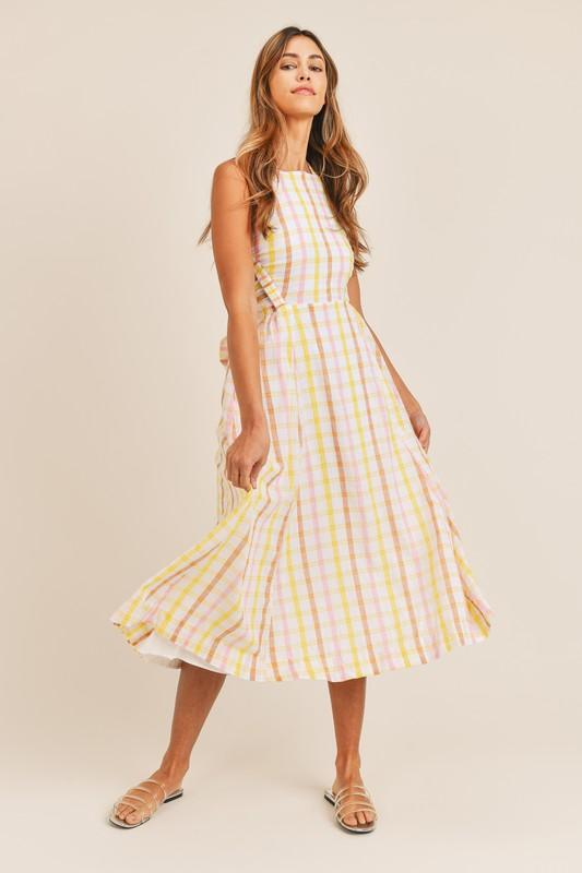 yellow and pink backless sundress in a midi length