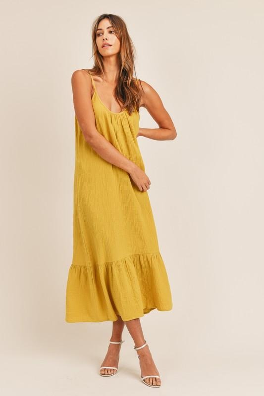 mustard yellow sundress with dropped ruffle at hem