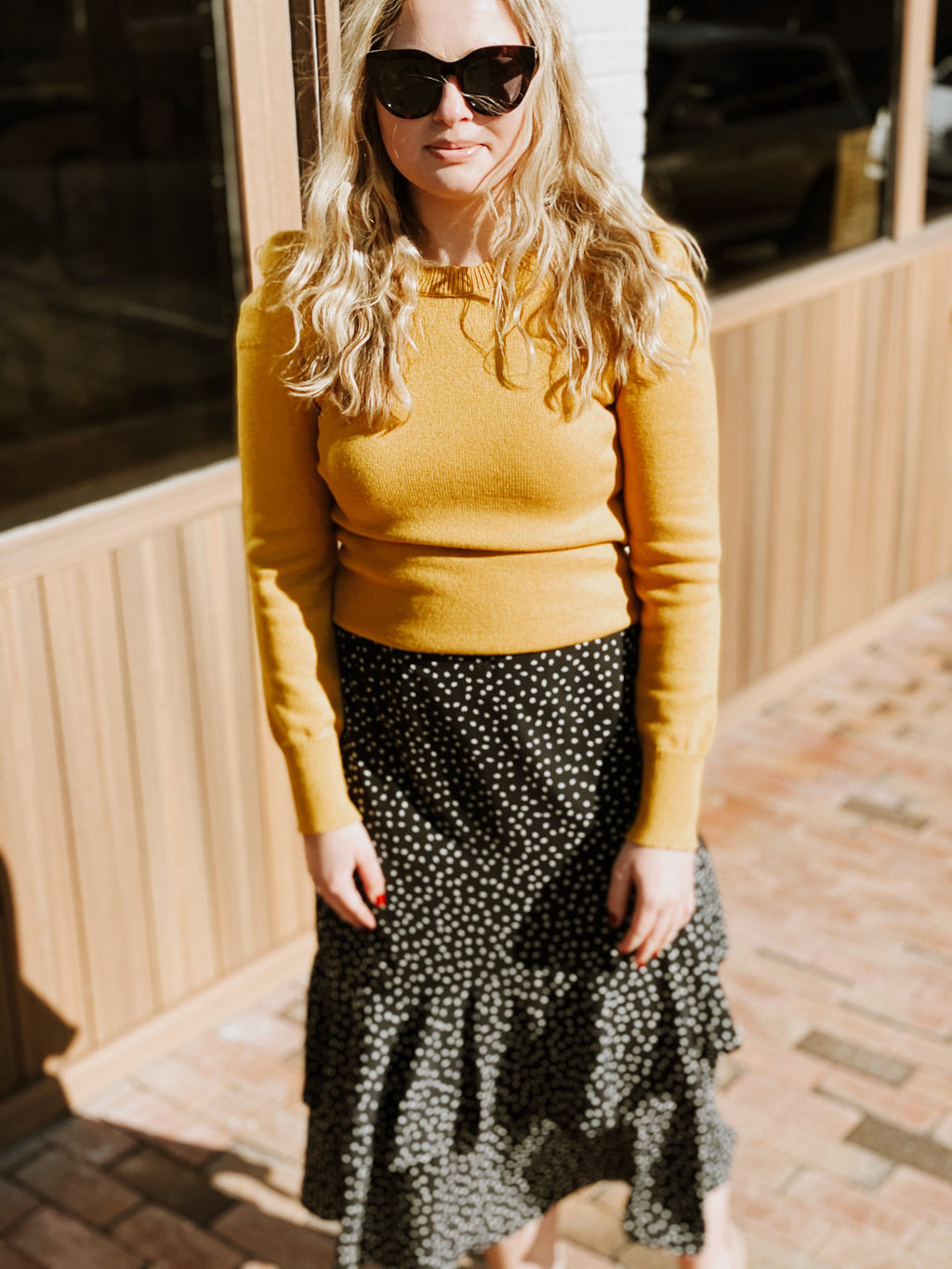 Mustard sweater with puff sleeves.  Fitted style that hugs the body throughout.