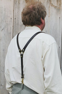 image of man wearing dark brown full grain premium solid leather suspenders braces with jeans with solid brass hardware handcrafted in our sustainable leather shop toronto