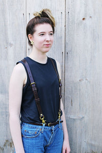 image of woman wearing dark brown full grain premium solid leather suspenders braces with jeans with solid brass hardware handcrafted in our sustainable leather shop toronto