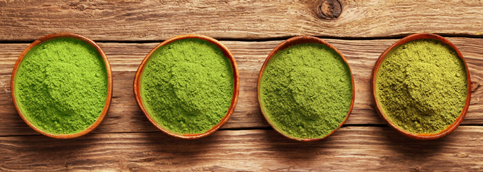 bowls with matcha green tea powder in different grades