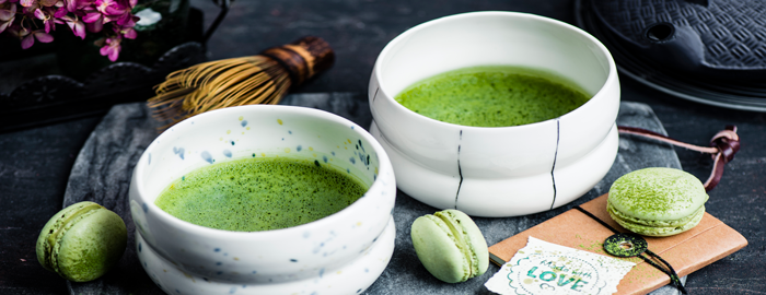 serving matcha green tee in bowl for two with matcha macaroons