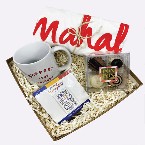 "Mahal gift box includes: Mahal t-shirt, ""Support your Friends"" mug, Helpers pin, and polvoron."