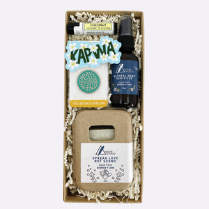 """Spread Love Not Germs"" gift box includes: Coconut lip balm, ""Brave, Grateful, Kind"" lapel pin, ""Kapwa"" sticker, natural hand sanitizer, and ""Spread Love Not Germs"" soap"