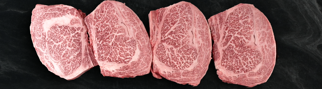 Picture of Japanese Kobe Ribeye steaks next to each other