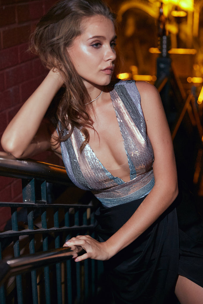 Beautiful New Years Eve party dress with striped sequin top and plunging neckline