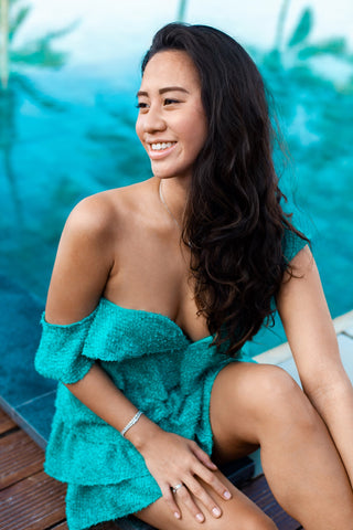 Gia mini dress in green by the pool