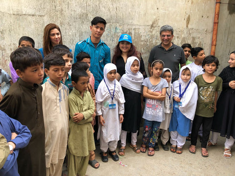 Huma Adnan with the children at the UNHCR refugee camp
