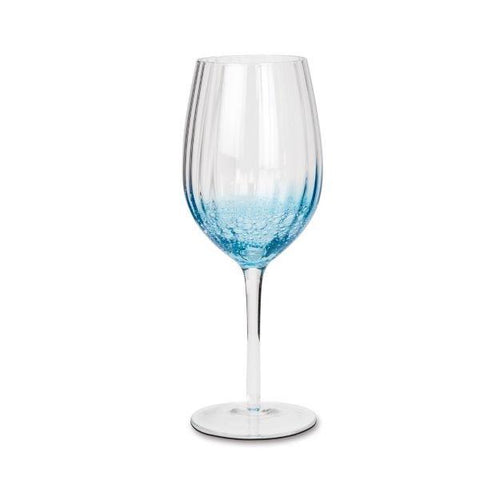 Red wine glass with blue bubbles