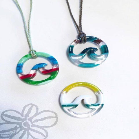 Upcycled surfboard resin wave on a cord necklace