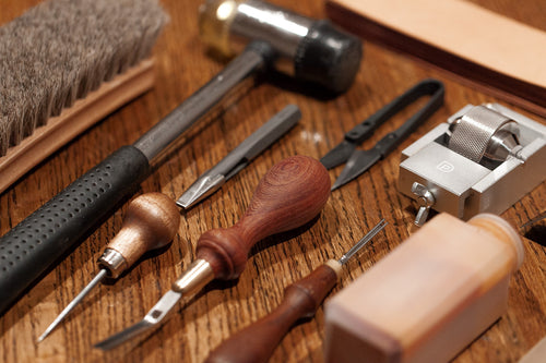 Leather working tools used to make each journal