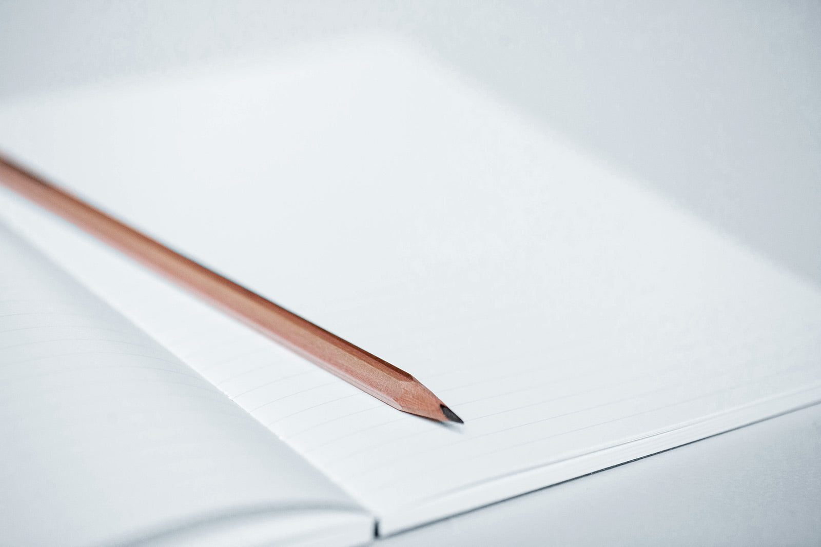 Open Notebook with a pencil