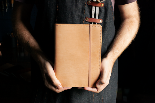 Leatherworker holding finished Classic Journal