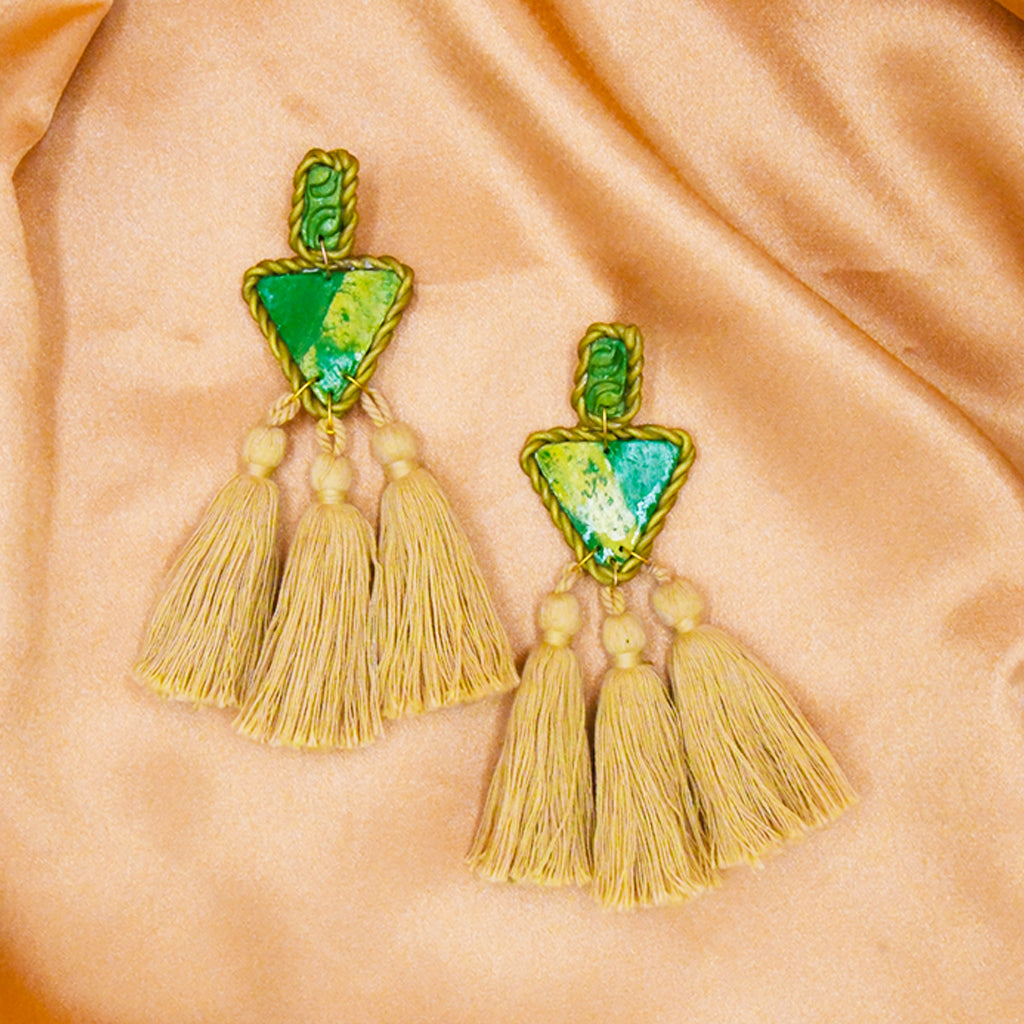 Add a splash of color to your look with the green Posh Tassel Earrings.