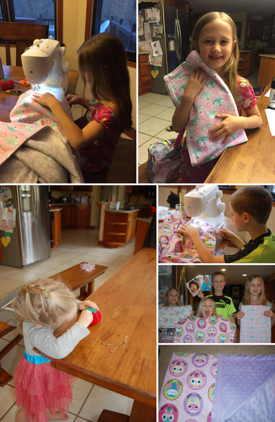 Young happy children sewing blankets together for children in need