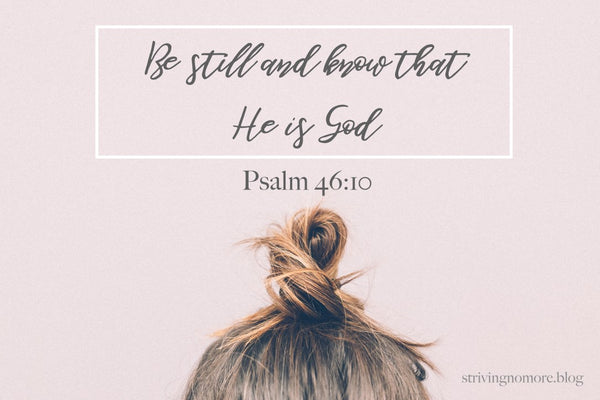 Young woman with hair pulled up in a small bun with Psalm 46:10 above their head