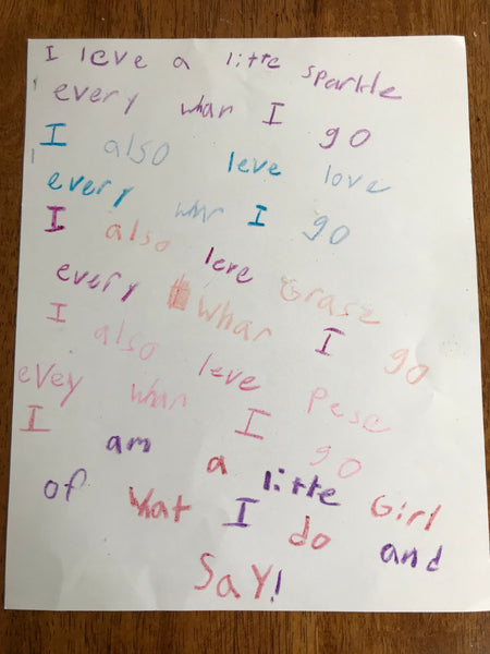 A young child's poem to their parent written in multiple colors of crayon