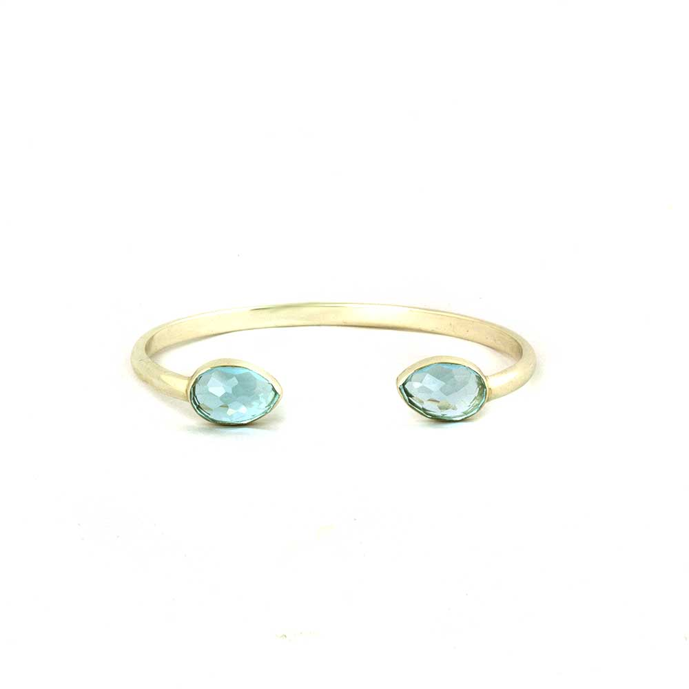 Gold plated silver cuff with fancy cut blue topaz