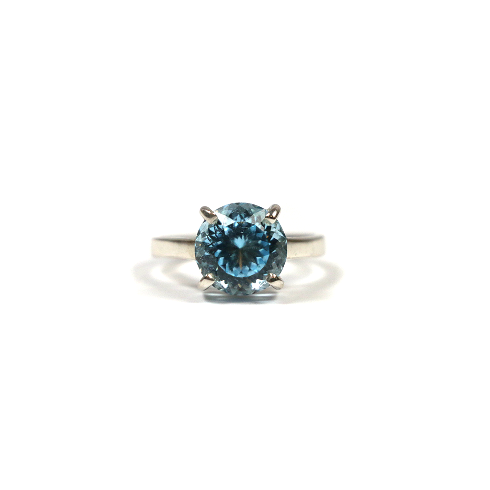 Handmade silver ring for women with fancy round cut blue topaz